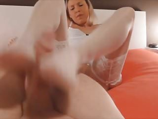 Hot footjob and cumming on her white stockings