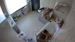 Bathroom voyeur spy of a hot MILF