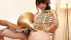 Musical talent blows in her horn then masturbates with it