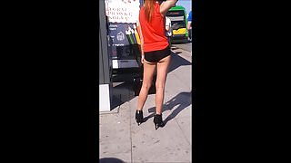 #95 Girl with sexy legs in mini shorts and high heels