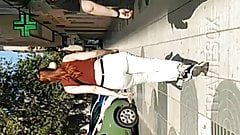 Candid redhead white pant