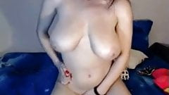 Sexy Milf with big natural breast rubs pussy and tits