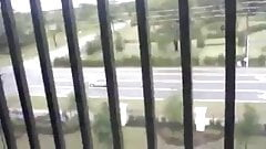 Girl Masturbates to Orgasm in her shorts on a Balcony
