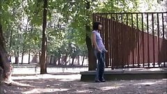 Brunette in blue jeans daring peeing in the park 1