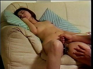 Sexy asian babe going wild as her pussy gets fingered and fucked on the couch