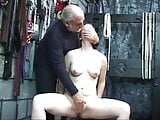 Dominant guy helps naked chick masturbate