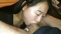 Asian babe deepthroating white cock