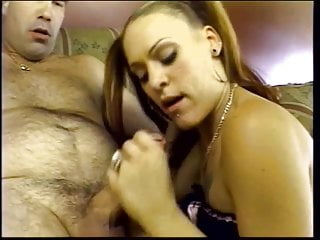 Young whore with large tits and knee-highs rides cock on couch