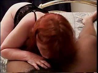 Mature redhead masturbates and deep throats dick in bed