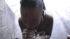 Ebony chick giving outside head