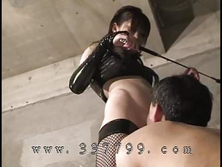 Japanese Mistress trains her slave with a whip