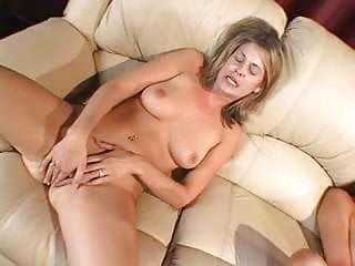Two girl get horny and finger their pussy on the sofa