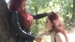 Latex babes Aradia and Krissy engage in lesbian BDSM outdoor