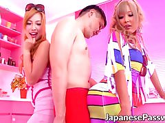 Two attractive young Japanese babes tease one horny bloke
