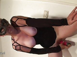 Kinky mama getting her boobs filled with young boy's cum