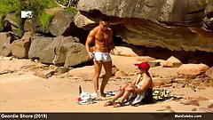 Joel Corry and Scotty T sunbathing naked on a beach