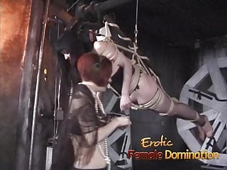Tied up suspended slave dominated by her kinky redhead frien