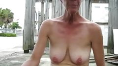 Mature flashing her saggy boobs