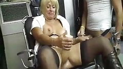 Naughty MILF dildoing her pussy while giving head to a guy
