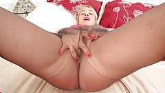 UK milf Olga fuels her horniness with black tights