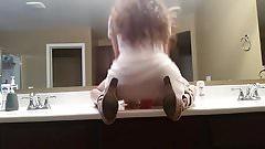 riding dildo in public bathroom