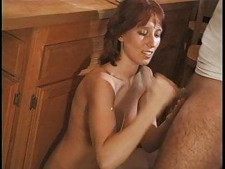 Tanned brun slut provocatively shags big brown boner on kitchen table