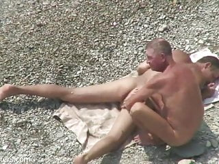 2 men wank and play on beach