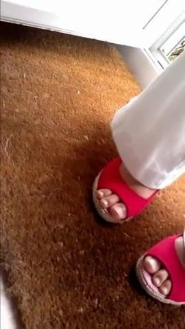 Friend's feet in red sandals