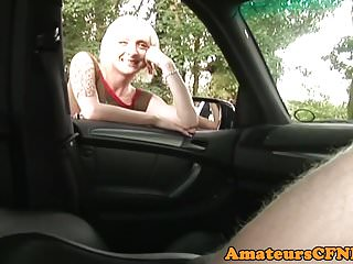 CFNM babe sucking cock in the back of a car