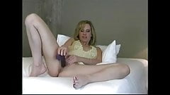 Hot blonde fucks herself hard with dildo