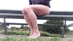 Pantyhose Public park bench outdoors .