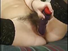 Amateur hairy wife plays with dildo