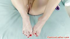 Bigtits beauty jerks big cock with her feet