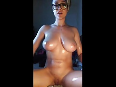 Cute girl oils her body and fingers her pussy Thumbnail