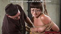 Mature Asian slave tortured with metal dildo and tit slaps