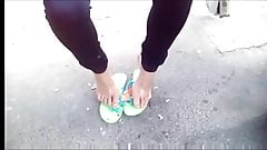 candid bare feet with flip-flops waiting bus HD