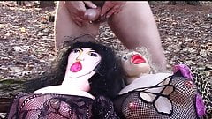 Two horny blow up dolls get erotic facial in the woods