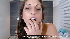 Piss drinking brunette loves to get wet!