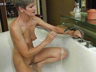 Mature amateur mom having bath time