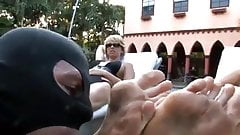 Two dominant ladies with a foot slave