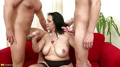 Mature sex bomb mom serves two young cocks