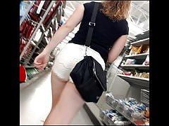 Nice ass in shorts of girl shopping