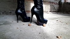 Crush nuts with high-heeled boots