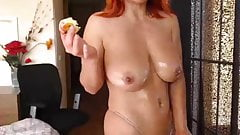 Busty redhead is having fun