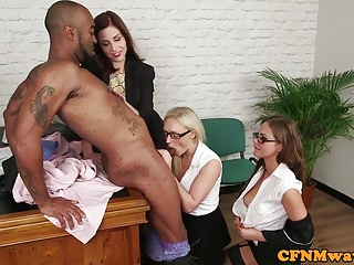 Glamorous office femdoms sucking black sub