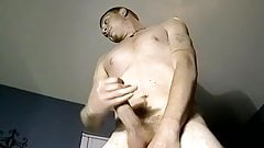 Studs stroke their dicks while standing and shoot their load