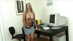 Busty slut has fun with vibrator at the workplace