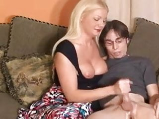 Milf gives boy handjob