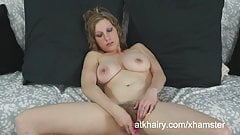 Sausha Packer plays with a toy in her hairy pussy