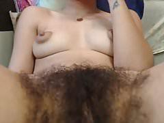Hairy gal, puffy nips  fingering pussy